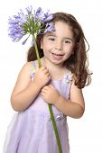 Little Girl Holding Large African Lily - Agapanthus