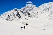 Small Group Of Mountain Trekkers In High Winter Himalayas Mountains