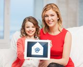 picture of mother and daughter with tablet pc and email icon