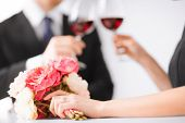 picture of fiance  - picture of engaged couple with wine glasses in restaurant - JPG