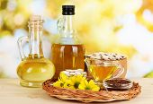 foto of flax seed oil  - Useful linseed oil and pumpkin seed oil on wooden table on natural background - JPG
