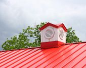 A Steeple On A Red Roof
