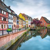 stock photo of alsatian  - Colmar Petit Venice water canal and traditional colorful houses - JPG
