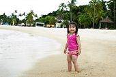 image of curio  - Young toddler at the beach having fun and is curios - JPG