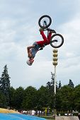 MOSCOW - AUG 4: Guy does somersaults on bike at All-Russian Exhibition Centre during holiday dedicat