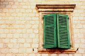 Window With Green Shutters In Old Wall (Italia)