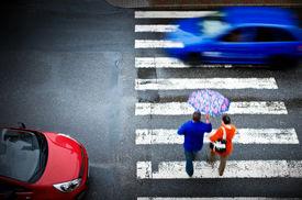 foto of street-walker  - pedestrian crossing with car in the rain - JPG