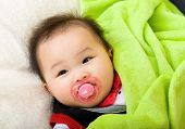 stock photo of pacifier  - Asian baby with pacifier - JPG