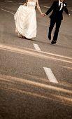 bride and groom's feet running