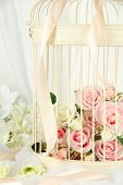 image of caged  - Beautiful decorative cage with beautiful flowers - JPG