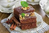 Slice of chocolate cake with nuts. Small Depth of Field (DOF)