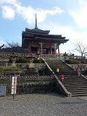 KYOTO, JAPAN - DECEMBER 30, 2013:  Tourists visit Koyomizu temple, a famous tourist attraction
