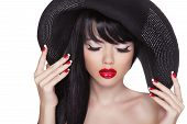 Beauty Fashion Sexy Girl Portrait In Black Hat. Red Lips And Polish Manicured Nails. Attractive Cute