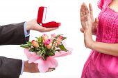 picture of rejection  - A man proposing with a ring and flowers and a woman rejecting