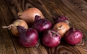 Onion on old, wooden table, shallow depth of field