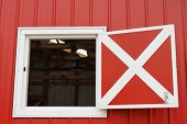 stock photo of red siding  - Red barn with large windows - JPG