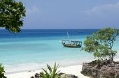 foto of breathtaking  - Wooden boat on turquoise water in Zanzibar - JPG