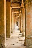 Ancient stone passage of Prasat Ta Prum or Ta Prohm Temple complex, near Siem Reap, Cambodia.