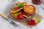 Fritters with strawberry jam and fresh strawberries