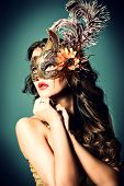 Portrait of a beautiful young woman in a carnival mask. Vintage