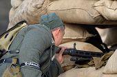 KIEV, UKRAINE -NOV 3: German MG-42 machine gun  (Red Star military history club)  during historical reenactment of WWII, Dnepr river crossing 1943, November 3, 2013 Kiev, Ukraine