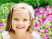 Outdoor Portrait Of Adorable Smiling Little Girl