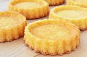 pic of sponge-cake  - Empty sponge cake flan cases on wooden tabletop - JPG