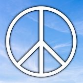 stock photo of universal sign  - Universal Peace sign over a sunny blue sky originally adopted as a nuclear disarmament and anti - JPG
