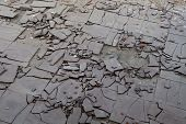 foto of asbestos  - Old and broken asbestos floor tiles in an abandoned house - JPG