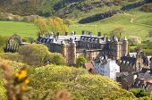 EDINBURGH - MAY 28: Panoramic view on the Palace of Holyroodhouse, official residence of the Monarch