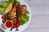 Chicken Drumstick With Lettuce, Tomatoes And Ketchup Top View