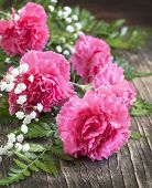 foto of carnations  - Bouquet of Pink Carnation On Wooden Background - JPG