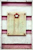 picture of communist symbol  - granite plate with Communist symbol on pink old wall - JPG