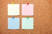 Blank sticky papers on cork wood notice board