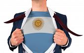 Businessman opening shirt to reveal argentina flag on white background
