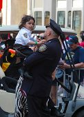 Little girl in NYPD held by father