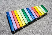 Colorful Wooden Xylophone On Gray Carpet Background Intop View