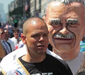Calle 13 Rene Perez with Oscar Rivera bust