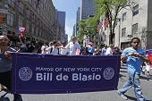 NYC Mayor Bill de Blasio with banner