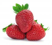 closeup of some appetizing strawberries on a white background