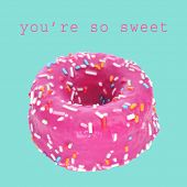 a colorful donut on a blue background and the sentence you are so sweet