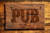 picture of draught-board  - rustic pub sign on a wooden wall - JPG