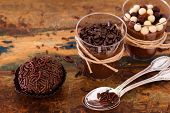 stock photo of chocolate spoon  - Brazilian chocolate bonbon truffle brigadeiro in glass with spoon on wooden table