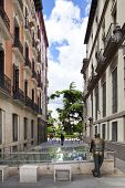 MADRID, SPAIN - MAY 28, 2014: Calle Mayor, Old Madrid city centre, busy street with people and traff