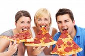 A picture of a group of friends eating big pizza slices over white background