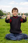 Cheerful Teenager Shows Thumb Up On The Esplanade Des Invalides In Paris
