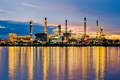 Petrochemical plant ( oil refinery ) industry at twilight time