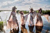 Pretty women with flower wreath in water