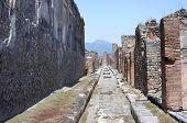 Street in Pompeii ruins near volcano Vesuvius Italy