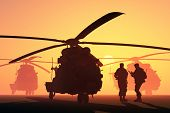 stock photo of military helicopter  - A group of military helicopters and the silhouette of a soldier - JPG